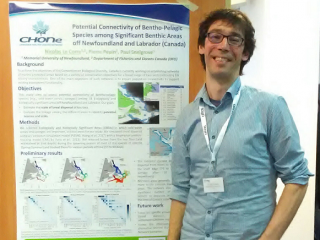 Nicolas Le Corre next to his poster at the 2018 ATLAS General Assembly in Majorca, Spain
